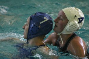 Two young women playing water polo